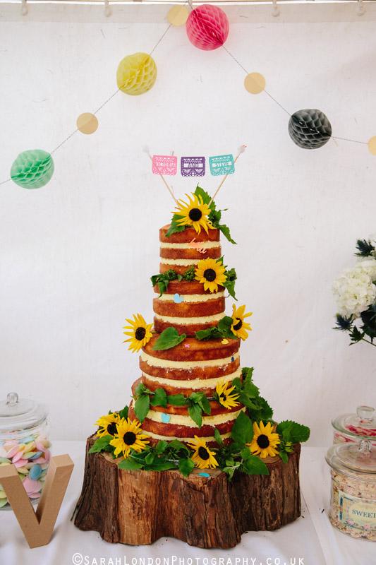 Naked wedding cake with sunflowers