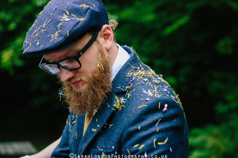 groom covered in confetti
