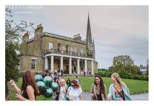 Guests leaving Clissold House with green Balloons.