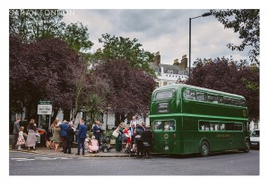 A green wedding bus to transport wedding guests to the reception.