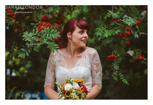 Autumn bridal portrait with red berries outside hackney city farm.