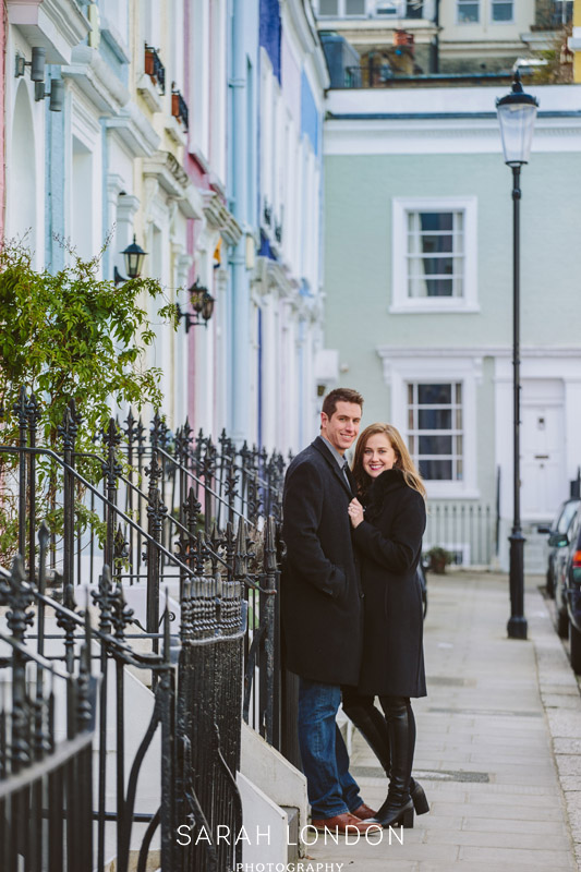 Newly engaged couple on colourful Notting Hill street
