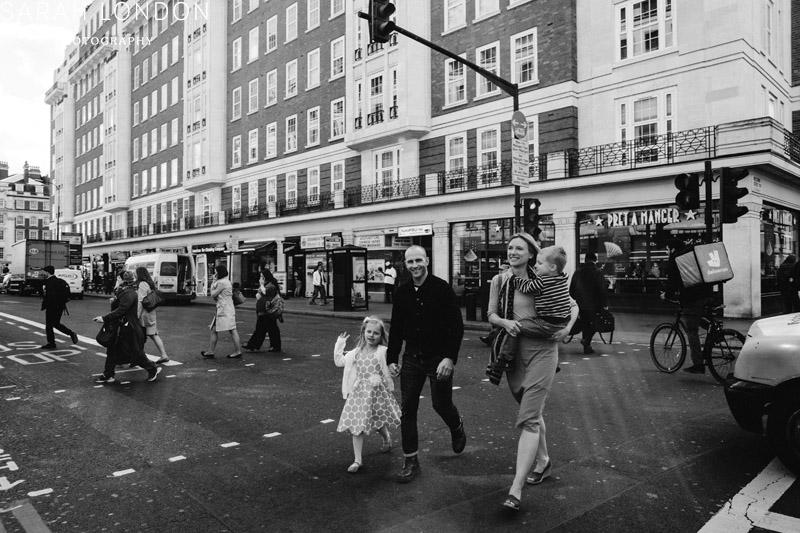 family cross a london road