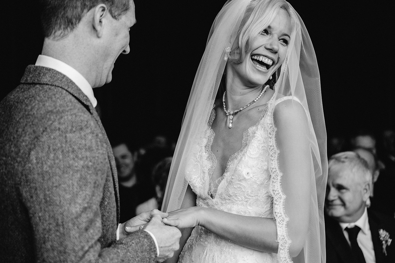bride laughing during ceremony at Cowdray House in West sussex