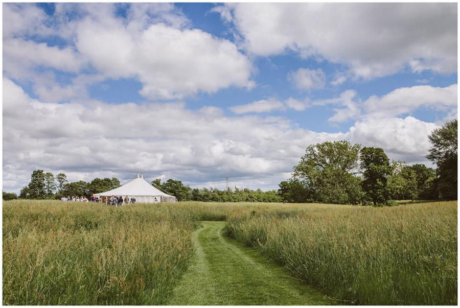 view across the meadow to the marquee at church farm
