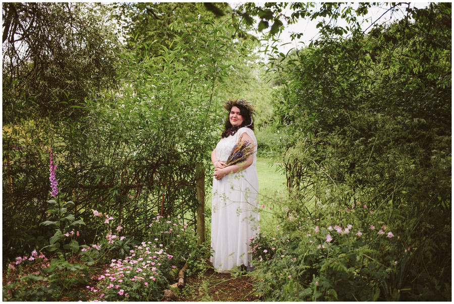 full length portrait of bride in flower garden at church farm