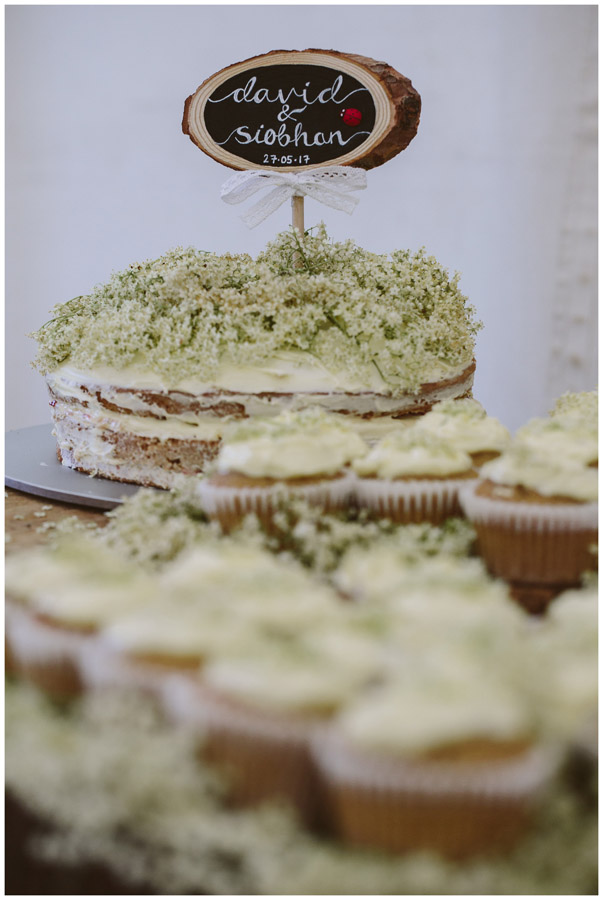 wedding cake with elderflowers on top