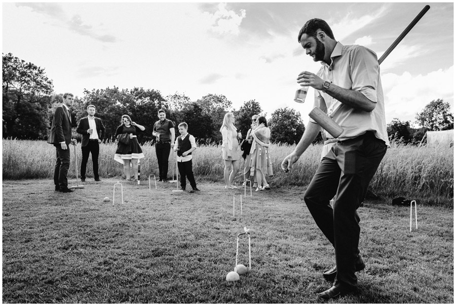 BW of guest playing polo at wedding in wiltshire