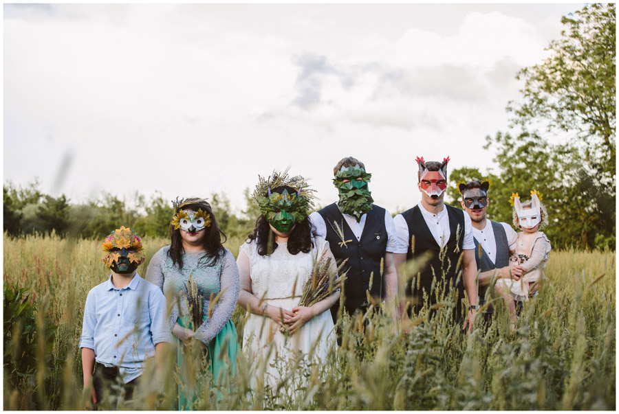 bridal party with folklore inspired masks