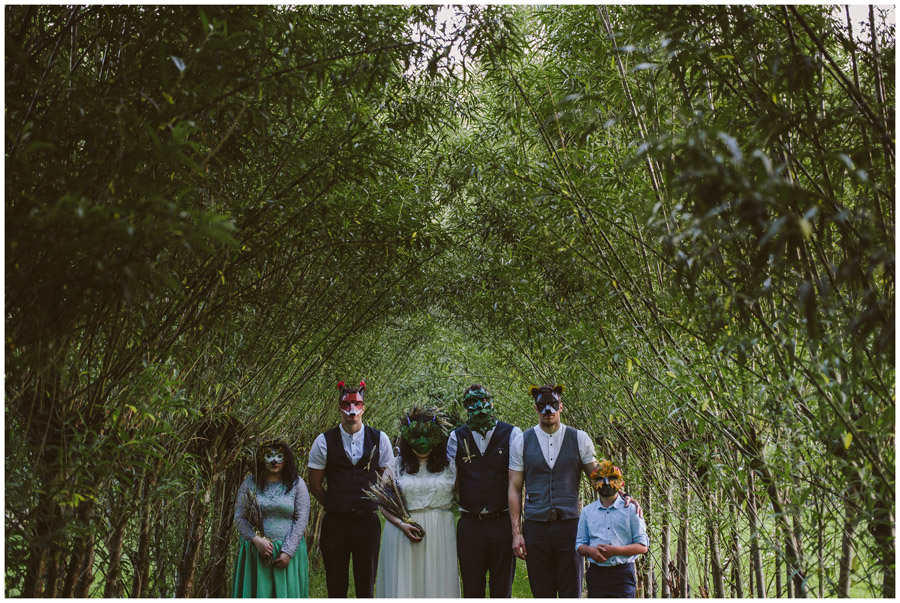bridal party wearing wicker man style masks