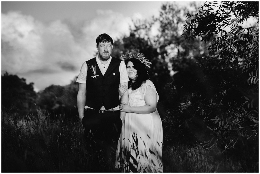 black and white of bride and groom at sunset in wiltshire