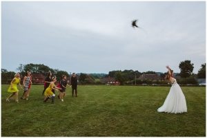 bride throws bouquet to single ladies