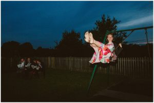 wedding guest on swing in lewes
