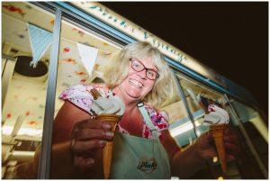 ice cream lady holding two ice creams