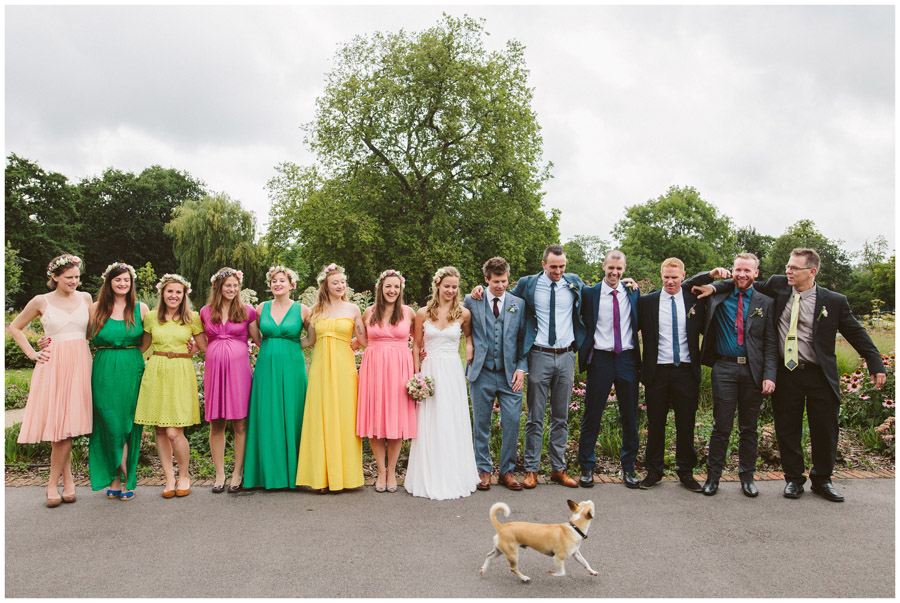 bridal party group shot with random dog walking past