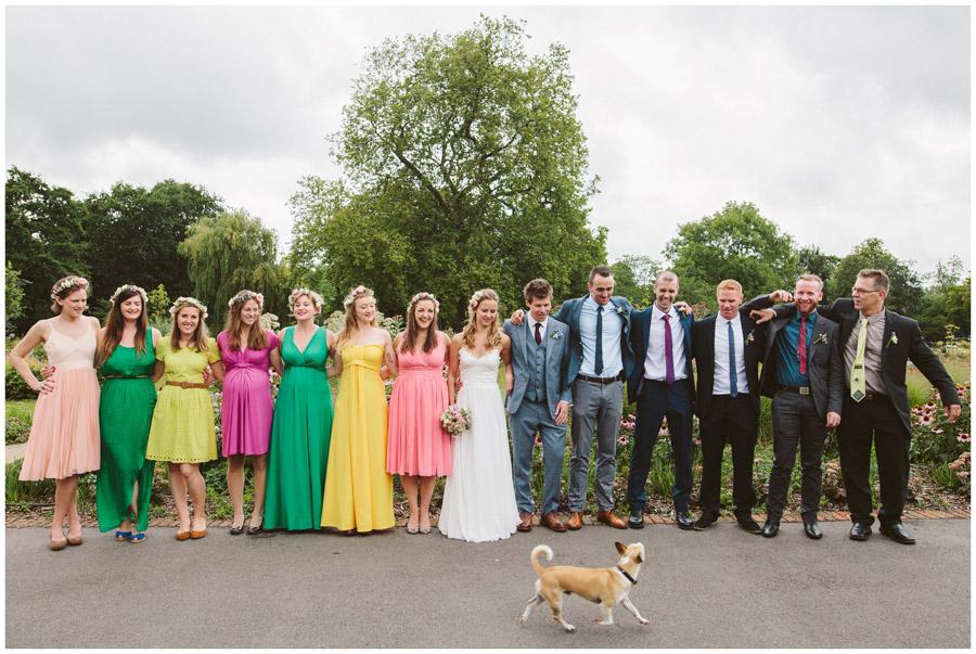 bridal party group shot with random dog walking past