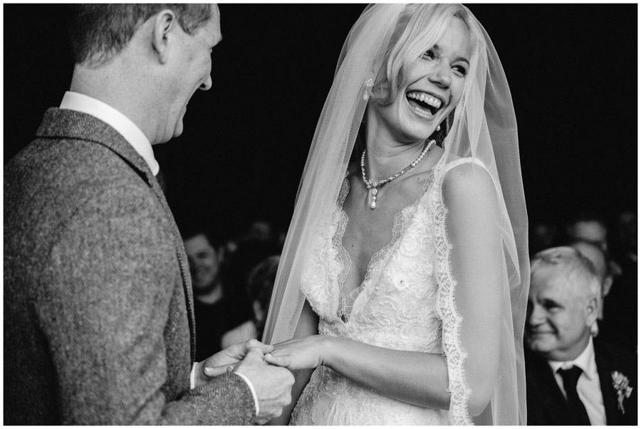 BW of bride and groom laughing during wedding ceremony