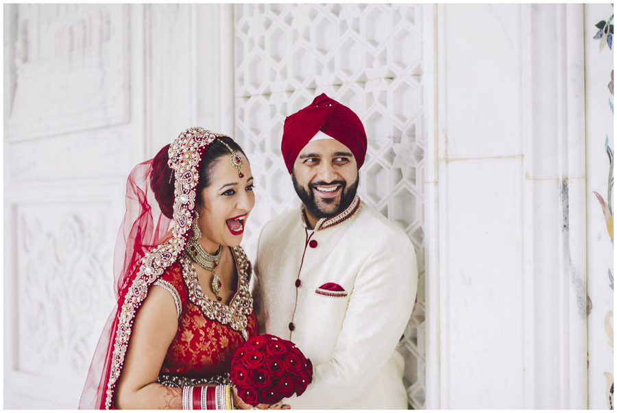 indian bride and groom laughing during portraits